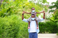 black dad and daughter outside