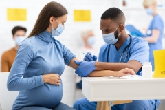 pregnant adult getting vaccinated