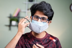 Young man wearing double face masks to protect from COVID-19 outbreak.