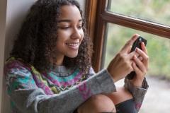teenage girl on her phone