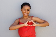 black women making heart sign with her hands