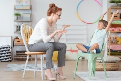 Child psychologist and young kid with ADHD