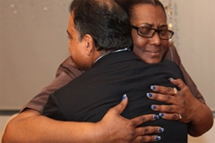 Nina Hubbard, who child received a kidney transplant at Weill Cornell Medicine, hugs Dr. Sandip Kapur