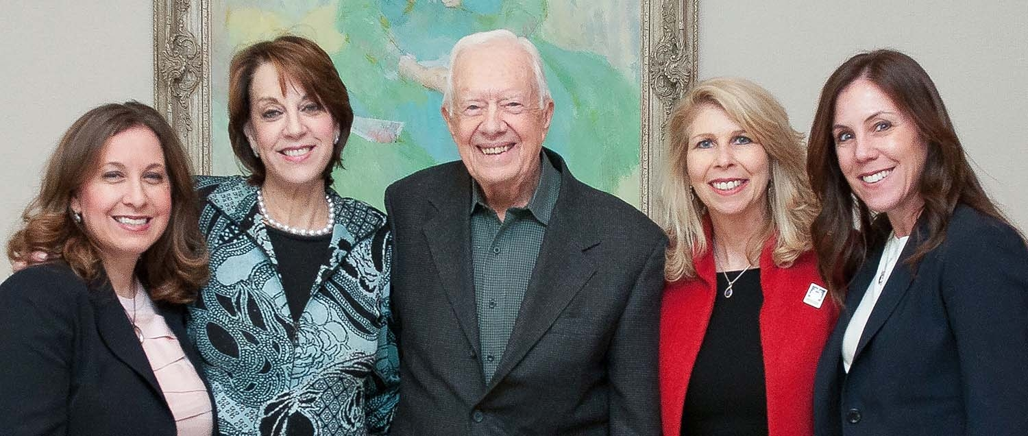 Dr. Allyson Ocean, Weill Cornell Medicine physician and co-founder of the pancreatic cancer advocacy group Let's Win, poses with the organization's co-founders and President Jimmy Carter, an honorary board member.